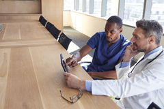Hospital Staff Meeting And Review Notes On Digital Tablet Stock Images