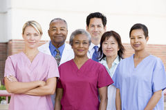 Hospital Staff Standing Outside A Hospital Stock Image
