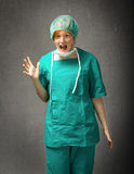 Hospital surgeon screaming Stock Photo