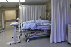 Hospital taste. A ward in a daily medical clinic in a South African city with beds for 8 people and all the nessarry apparatus. It is not only very spacious and royalty free stock photo