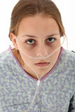 Hospital Teen. Ill american 16 year old girl in hospital gown with oxygen tube over white background Stock Photos