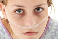 Hospital Teen. Ill american 16 year old girl in hospital gown with oxygen tube over white background Stock Photography