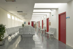 Hospital waiting area with gray metallic chairs. Stock Photos