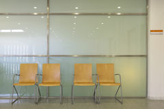Hospital waiting area with metallic chairs. Royalty Free Stock Photography