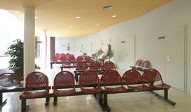 Hospital waiting area with red metallic chairs. Royalty Free Stock Photos