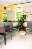 Hospital waiting room. Waiting room in a hospital or clinic with empty chairs stock image