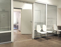 Hospital waiting room with chairs and open door. Hospital waiting room picture with chairs and open door Royalty Free Stock Photography