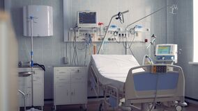 A hospital ward for one person with a bed and equipment. 4K stock video footage