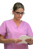 Hospital Worker. Young woman in hospital srubs holding a file, isolated on white background Stock Photo