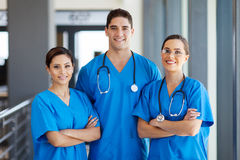 Hospital workers group. Group of young hospital workers in scrubs royalty free stock images