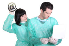 Hospital workers sending e mail. Hospital workers sending an e mail royalty free stock photos