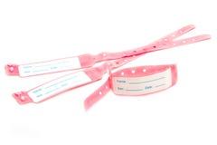 Hospital wrist tag on white Royalty Free Stock Photos