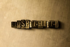 HOSPITALITY - close-up of grungy vintage typeset word on metal backdrop. Royalty free stock illustration.  Can be used for online banner ads and direct mail Stock Images