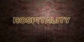 HOSPITALITY - fluorescent Neon tube Sign on brickwork - Front view - 3D rendered royalty free stock picture. Can be used for online banner ads and direct Stock Photos