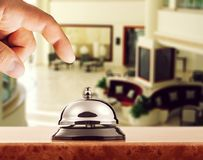 Hospitality. Hotel alert arrival background bell bellboy stock photography