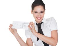 Hospitality hostess presenting a voucher. Smiling welcoming hospitality hostess presenting a voucher in her hands isolated on white stock image