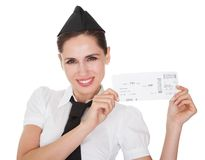 Hospitality hostess presenting a voucher. Smiling welcoming hospitality hostess presenting a voucher in her hands isolated on white stock images