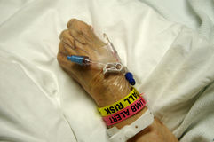 Hospitalized Elderly Patient. Elderly patient's hand With device on hand for  infusing medication Stock Images