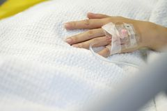 Hospitalized Patient Hand Inserted With Intravenous Drip. Close-up of hand of a hospitalized patient inserted with intravenous drip. Shallow depth of field Stock Photos