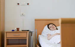 Hospital patient. Woman in hospital room Royalty Free Stock Images