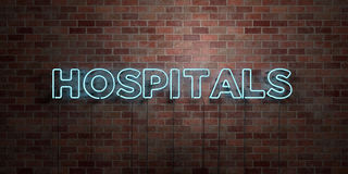 HOSPITALS - fluorescent Neon tube Sign on brickwork - Front view - 3D rendered royalty free stock picture Stock Images