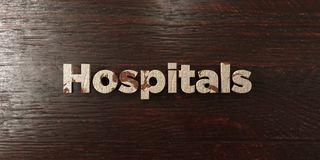 Hospitals - grungy wooden headline on Maple  - 3D rendered royalty free stock image Royalty Free Stock Photography