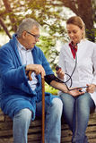 Hospitals, Labs and Clinics- assessment of blood pressure elderl. Hospitals, Labs and Clinics- Nurse assessment of blood pressure elderly man royalty free stock photography