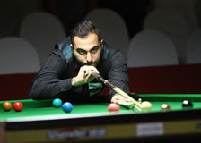 Hossein Vafaei Ayouri of Iran. Bangkok, Thailand - SEP 1:Hossein Vafaei Ayouri of Iran participates in a Sangsom Six-red World Championship 2014 at Montien royalty free stock image