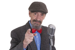 Host with microphone pointing towards audience Stock Photos