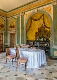 The host table of Edmond Rostand. In the dining room of Villa Arnaga, French-style table with orangeade, silverware and various table accessories royalty free stock image