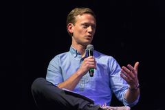 Host Tommy Vietor Pod Save The World. LOS ANGELES, CALIFORNIA - JANUARY 17, 2018: Pod Save The World host Tommy Vietor discussing the documentary `The Final Year Stock Photos