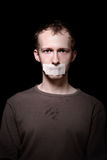 Hostage on black. Portrait of a hostage on black background Royalty Free Stock Photos
