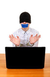 Hostage in Handcuffs behind Laptop Stock Photo