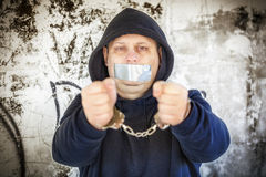 Hostage in handcuffs Royalty Free Stock Photo