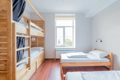 The hostel dormitory beds arranged in room. Hostel dormitory beds arranged in room royalty free stock images