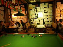 Hostel Life in Chengdu. Good traveler life. Snooker, Pool, Sit a stock image