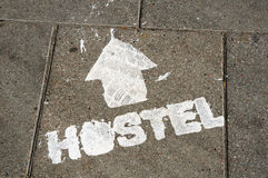 Hostel sign on the ground Royalty Free Stock Photos