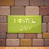Hostel Signboard With Address On Brick Wall Stock Image