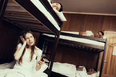 Girl woke up early and got up first in Hostel royalty free stock photos