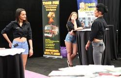 Hostess girls at car-moto salon Stock Photography