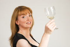 Hostess with glass Royalty Free Stock Image