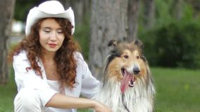 Hostess With Her Dog stock video footage
