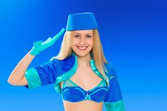 Hostess making salute gesture. Stewardess Stock Photography