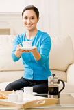 Hostess offering coffee to guest Royalty Free Stock Photography