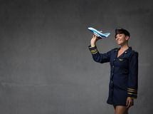 Hostess plaing with a toy plane stock image