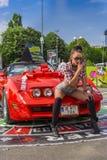 Hostess posing near Corvette car Royalty Free Stock Photos