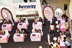Hostesses from AMWAY are advising customers how to use their pro Stock Images