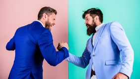 Hostile or argumentative situation between opposing colleagues. Business partners competitors office colleagues tense. Faces ready to compete in arm wrestling stock photography
