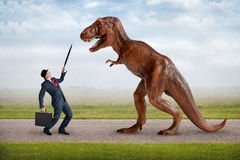 Hostile business takeover concept. Businessman and tyrannosaurus stock photo