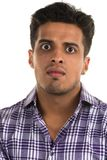 Hostile man. Handsome young Indian man with an aggressive expression royalty free stock photos
